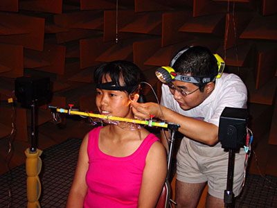 Peter Zhang and Yongfang Zhu set up the VRX experiment in the anechoic room at Michigan State University. photo